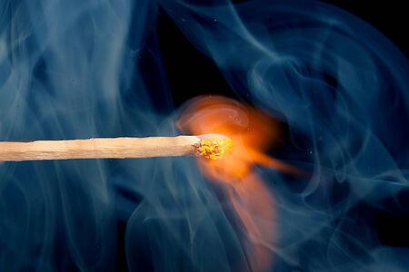 matchstick: burning matchstick on black background