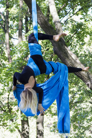 young gymnast: Young gymnast doing exercise on aerial silks