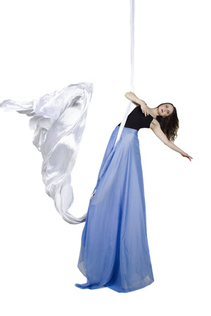 acrobatic: Pretty woman - aerialist doing acrobatic tricks on aerial silks Stock Photo