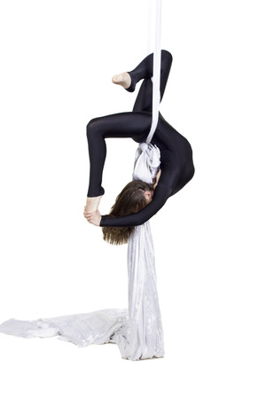 silks: Pretty woman - aerialist doing acrobatic tricks on aerial silks Stock Photo