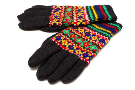 spokes: Handmade multicoloured gloves with old russian pattern Stock Photo