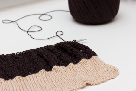 neutral: Hand knitted cloth by spokes on neutral background