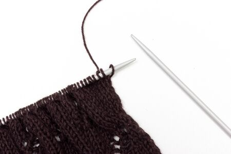 spokes: Hand knitted cloth by spokes on neutral background
