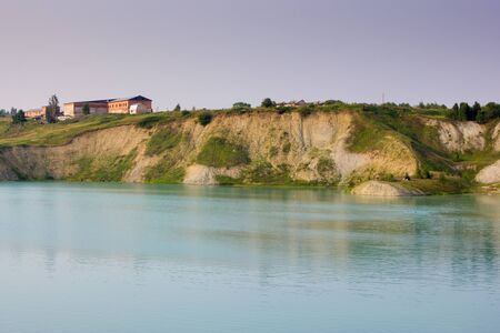 rule of thirds: Beautiful landscape of lake in the quarry in summer, golden hour, Uchta