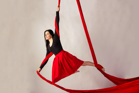 beautiful aerialist girl doing acrobatic and flexible tricks on red aerial silks  tissues  on aerial silks stock photos  royalty free business images  rh   123rf