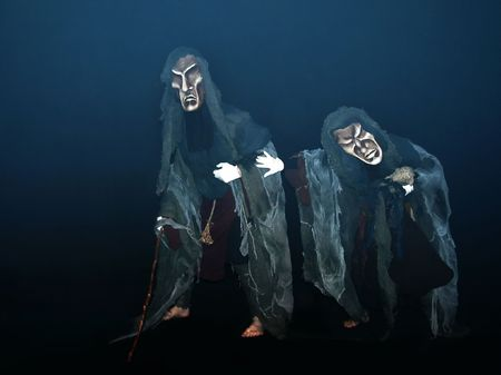 dreary: Pair of actors in masks during performance. Stock Photo