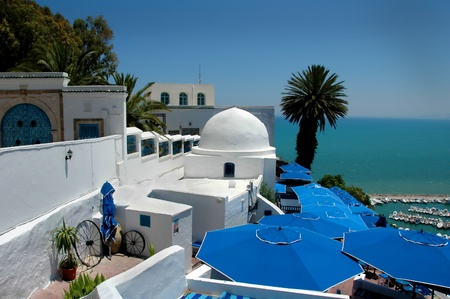 horison: Cafe under umbrellas near the mooring line in Mediterranean Sea in Tunisia. Stock Photo