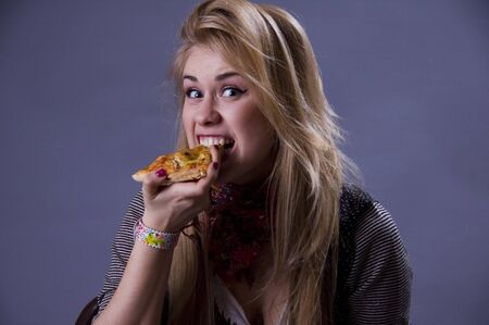 Excited girl with pizza. photo
