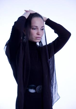 Despair of woman in black. photo