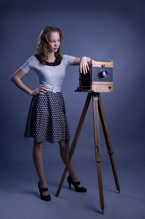 Beautiful woman with camera obscura. photo