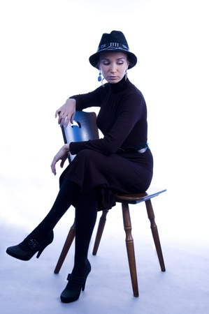womanlike: Woman in black on thr chair.