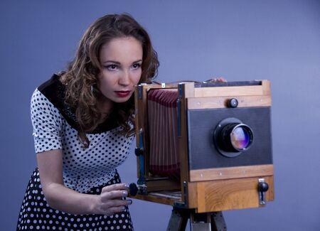obscura: Beautiful woman with camera obscura. Stock Photo