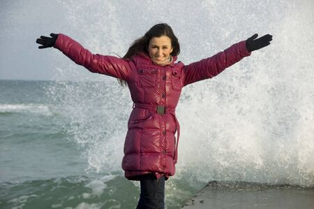Girl against sea wave. photo