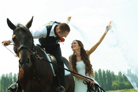 horse saddle: Happy wedding couple.