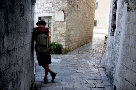 Resting traveller in the narrow street,of Croatian town. photo