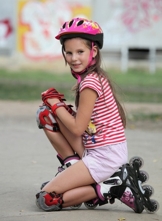 Girl in helmet and roller skates  photo