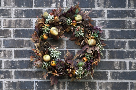 Festive wreath on black brick wall  photo