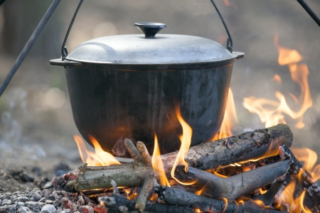 Cooking on campfire  photo