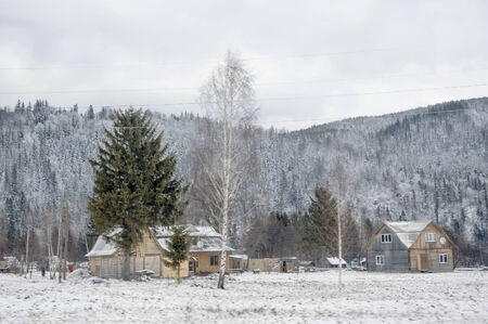 Little settlement in Carpathian Mountains in wintertime  photo