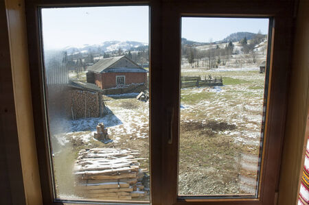 Landscape of Ukrainian village through the window  photo