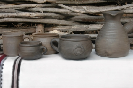 Traditional Ukrainian ceramics handcrafts against palisade  photo
