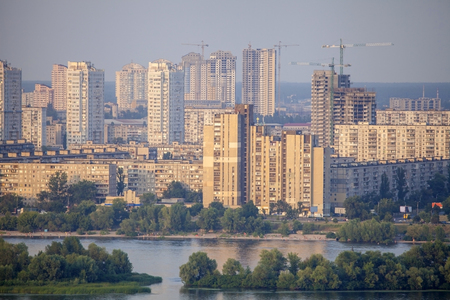 residencial: View of the new residencial district in Kyiv city on the bank of the Dnieper River during sunset