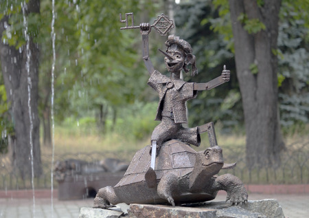 fictional character: Fountain sculpture - Pinocchio with golden key on the turtle - a  fictional character from the fairytale  The Golden Key, or the Adventures of Pinocchio