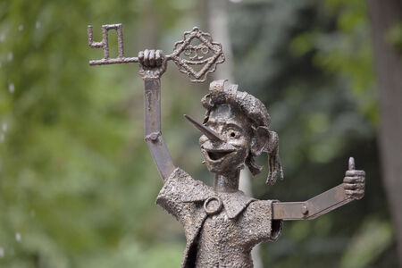 fictional character: Fountain sculpture - Pinocchio with golden key - a  fictional character from the fairy tale  The Golden Key, or the Adventures of Pinocchio