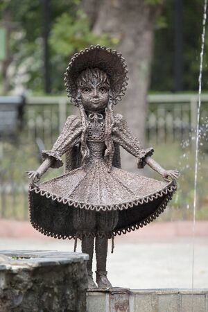 named person: Detail of fountain in the park - fictional character from fairy tale    The Golden Key, or the Adventures of Pinocchio  , Malvina
