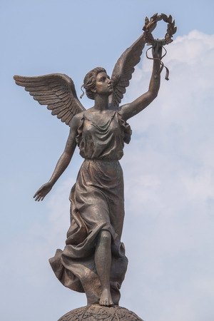 named person: Monument to the Goddess of victory Nike in Kharkov against the sky