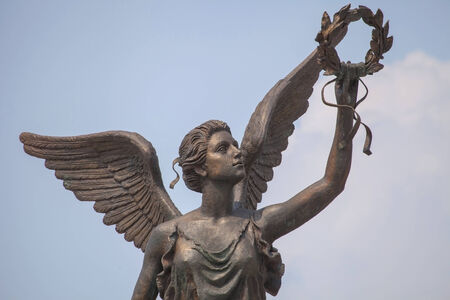 named person: Detail of monument to goddess of victory Nike in Kharkov, Ukraine, against the sky