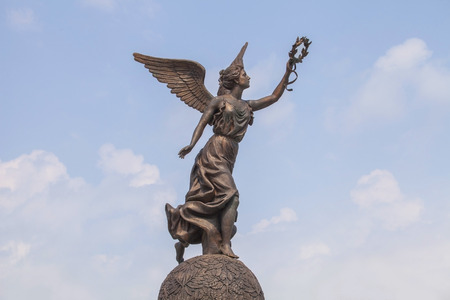 named person: Monument to the Goddess of victory Nike in Kharkov against the clouds and sky