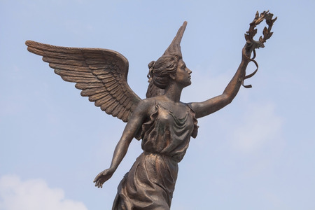 Part of monument to the Goddess of victory Nike in Kharkov against the clouds and sky