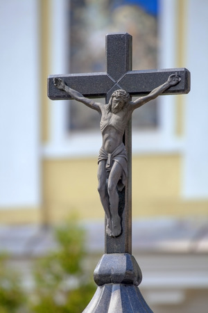 tortured body: Crucifix on the top of chapel in Kharkov