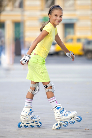 Smiling girl on the roller-skates Stock Photo