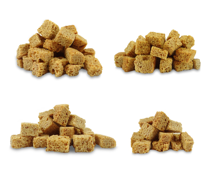 Side view of a portion of croutons isolated on a white background.