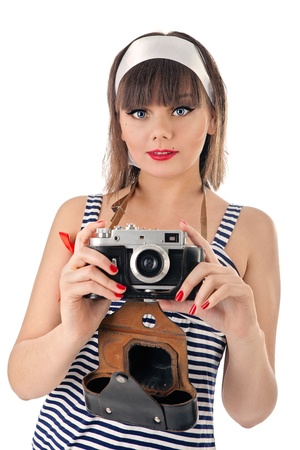 Portrait of young beautiful girl holding old camera photo