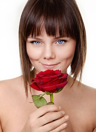 Portrait of young beautiful girl holding red rose photo