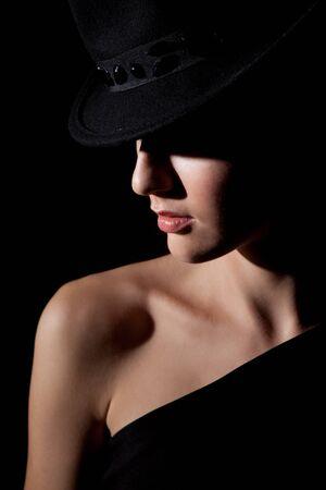 lowkey: Low key portrait of beautiful girl in black hat
