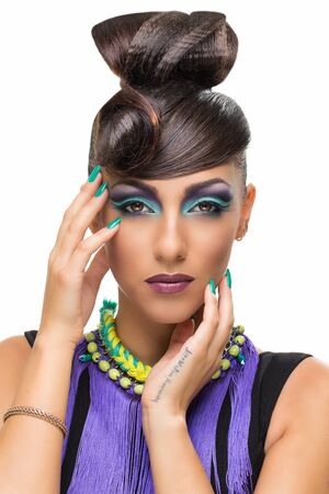 Portrait of beautiful girl with fancy hairstyle and bright makeup over white background photo