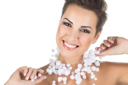 beautiful smile: Portrait of beautiful smiling girl with artificial snow Stock Photo