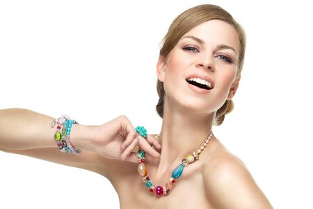Portrait of beautiful girl with colorful accessories over white background photo