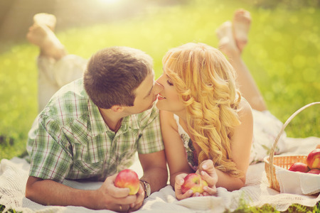 Beautiful married couple having romantic picnic outdors on summer sunny day photo