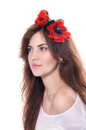artificial hair: Young beautiful brunette with artificial poppies in her hair Stock Photo
