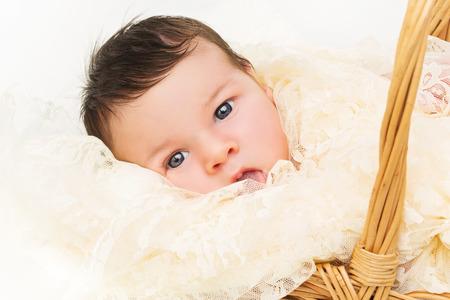 guipure: Newborn baby in guipure blanket lies in wicker basket Stock Photo