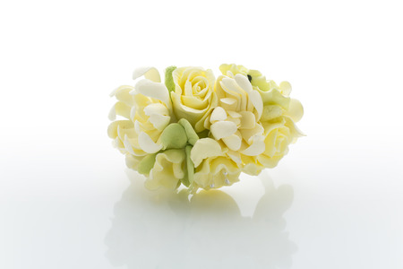 buttonhole: Close up of handmade wedding floral accessory. Decoration for hands or buttonhole. Isolated over white background Stock Photo