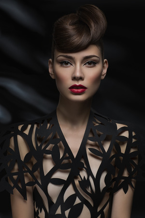 Sexy sensual woman with red lips and a fashionable blouse Standard-Bild