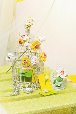 Set of two cages with flowers and decorated envelopes. Wedding gifts. photo