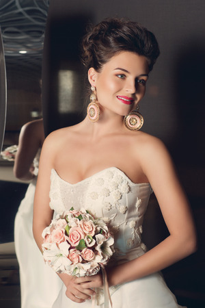Beautiful Young Bride In Stylish Wedding Gown Standing Near Fancy ...