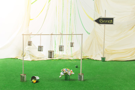 aluminum cans: Wedding entartainment. Game with aluminum cans and wool balls.